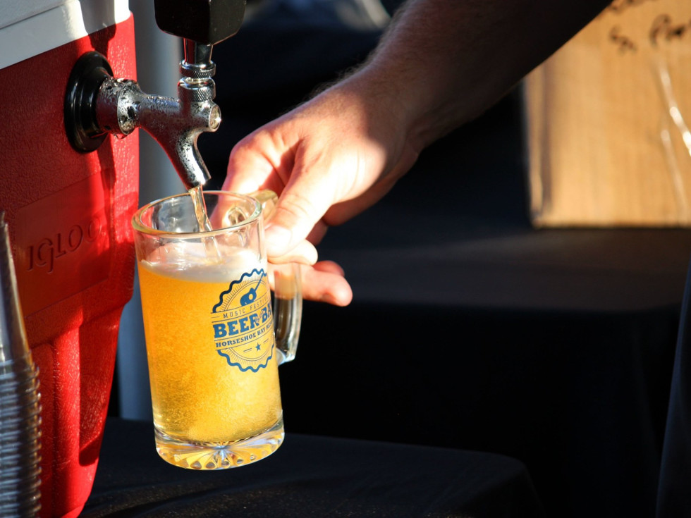 Horseshoe Bay Beers by bay draft pouring hand