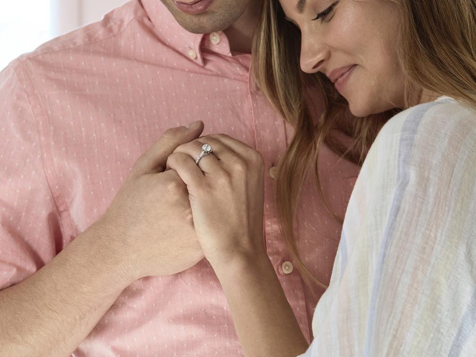 Man and woman looking at engagement ring