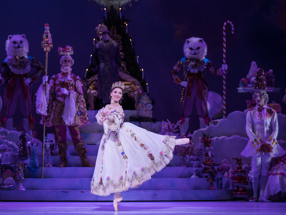 Houston Ballet Principal Melody Mennite as Clara with Artists of Houston Ballet in Stanton Welch's The Nutcracker