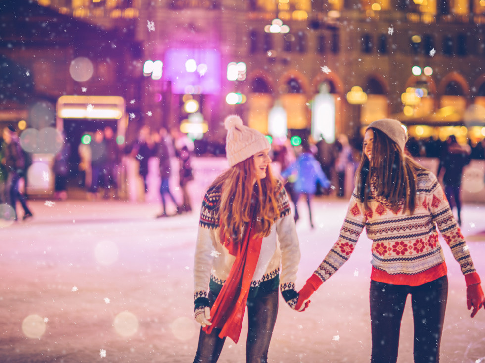 Two young women ice skating