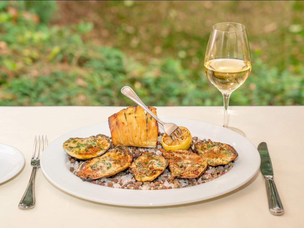 Wood-fired Gulf oysters at Tribute