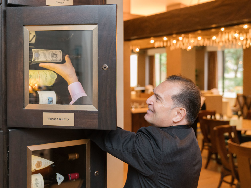 TRIBUTE's wine story begins with rows of back-lit wine lockers tended by maître d' Frank Perez