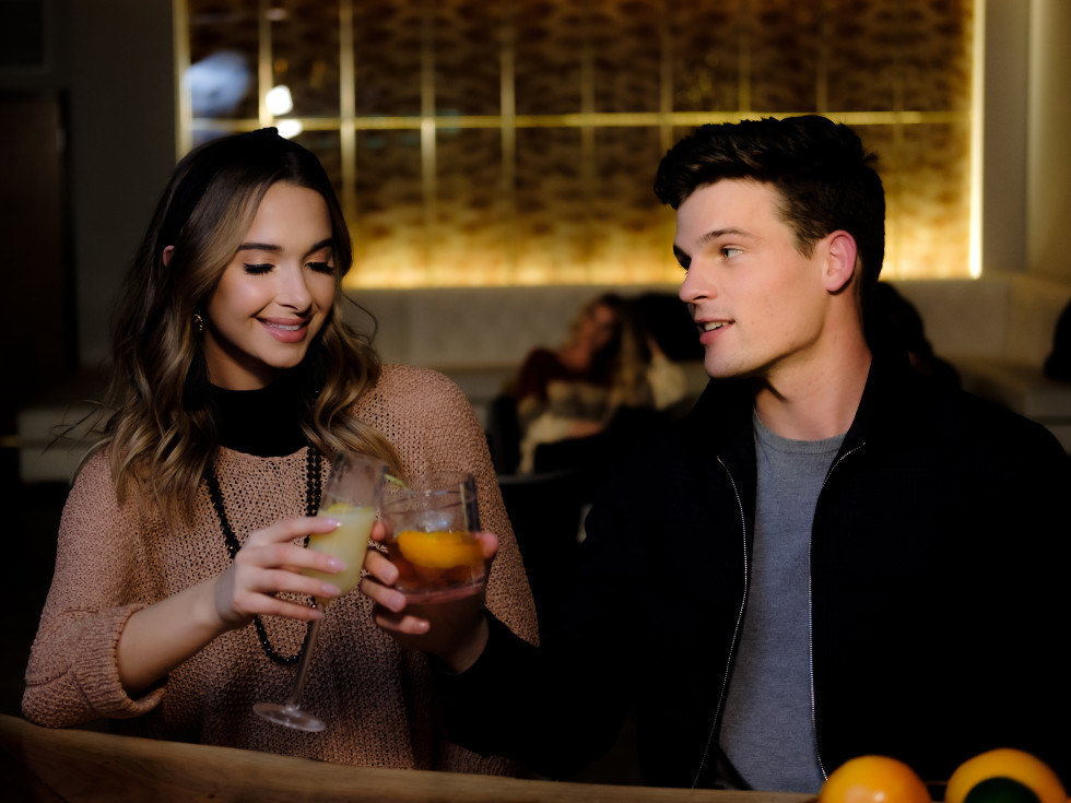 Couple with drinks at Waterproof bar