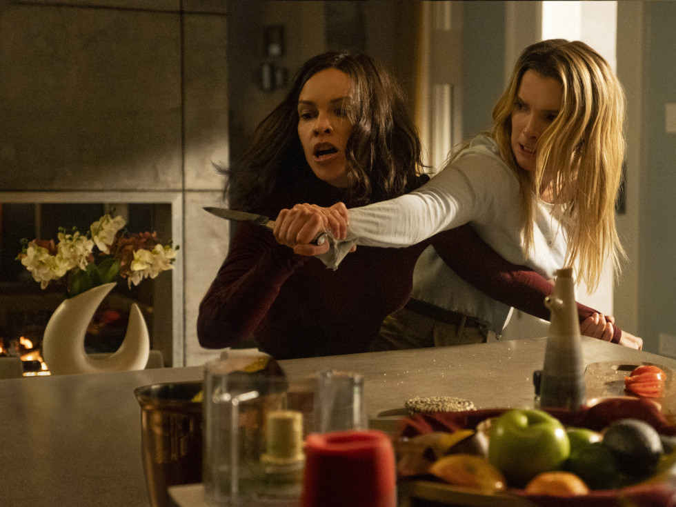 The Hunt movie review Athena (Hilary Swank) and Crystal (Betty Gilpin) in The Hunt