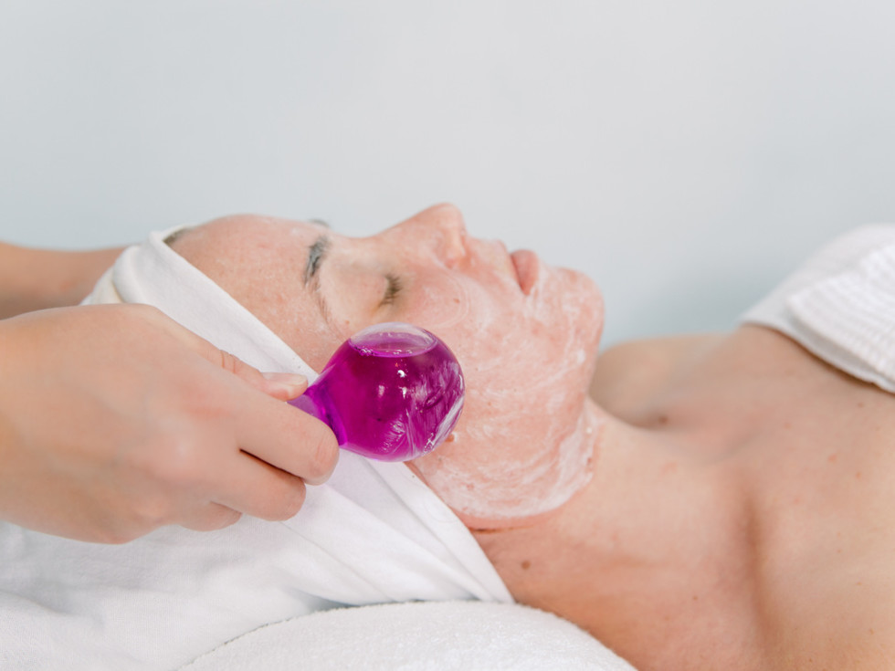 Woman receiving a facial at Bare Necessities Spa