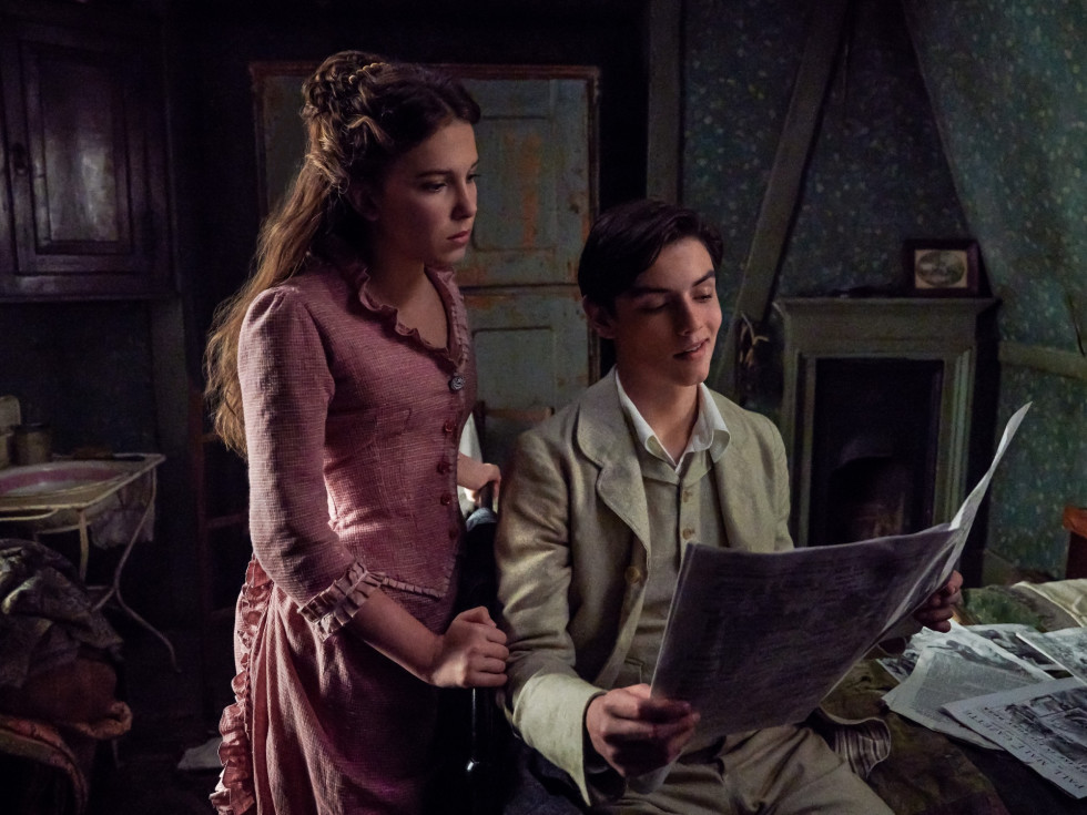 Millie Bobby Brown and Louis Partridge in Enola Holmes