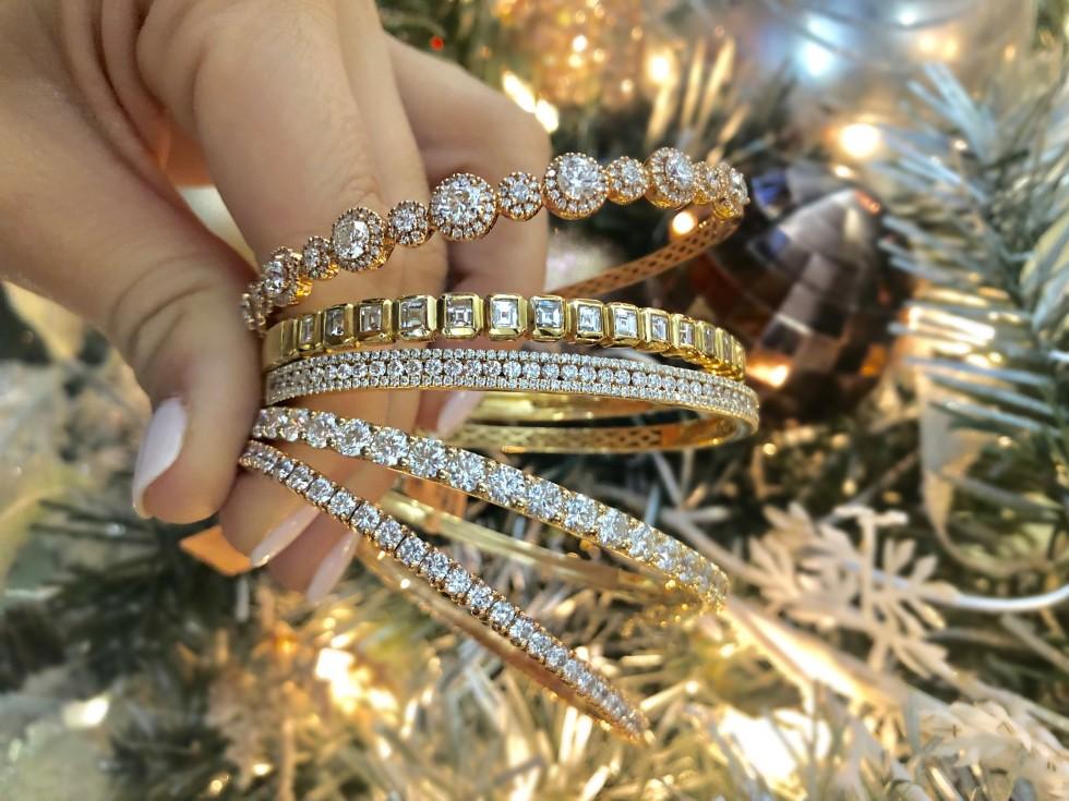 Diamond bracelets in front of Christmas tree