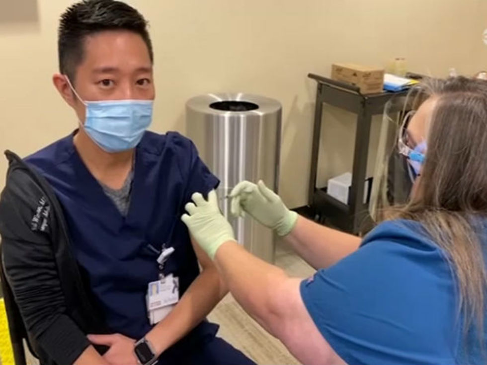 COVID vaccine Houston worker