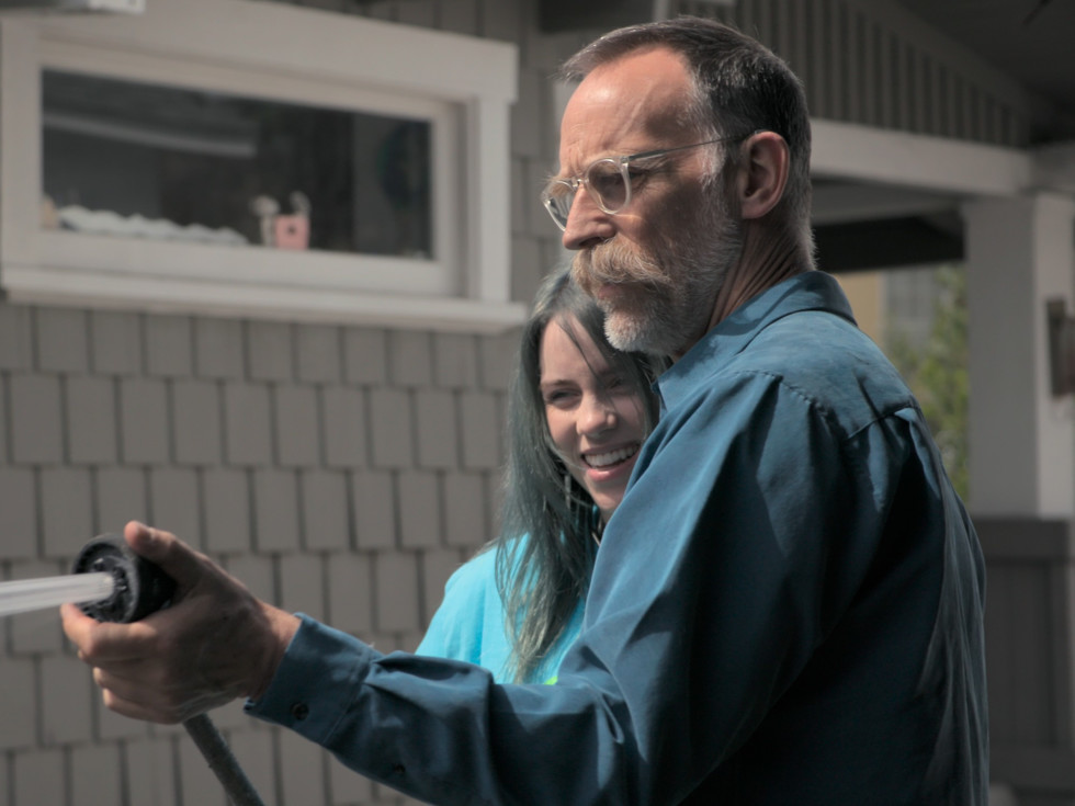 Billie Eilish and her dad Patrick O'Connell in Billie Eilish: The World's a Little Blurry