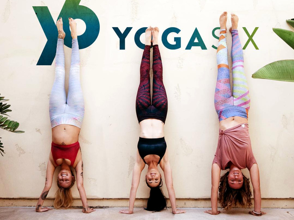 Yoga women upside down post Yoga Six hand stand