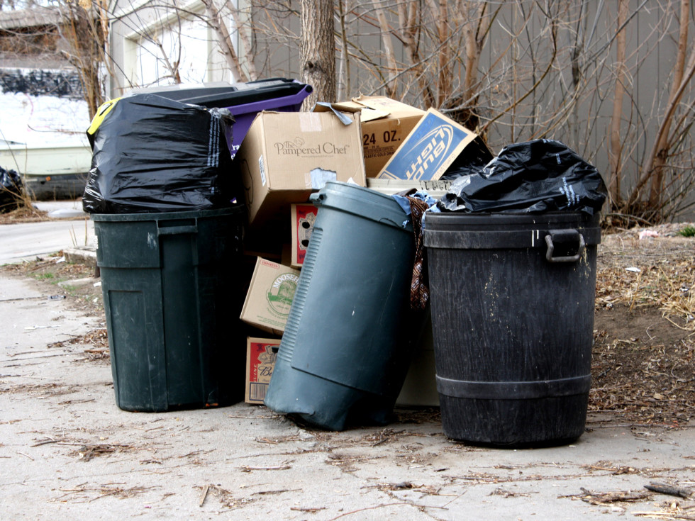 garbage cans overflowing with trash DAY
