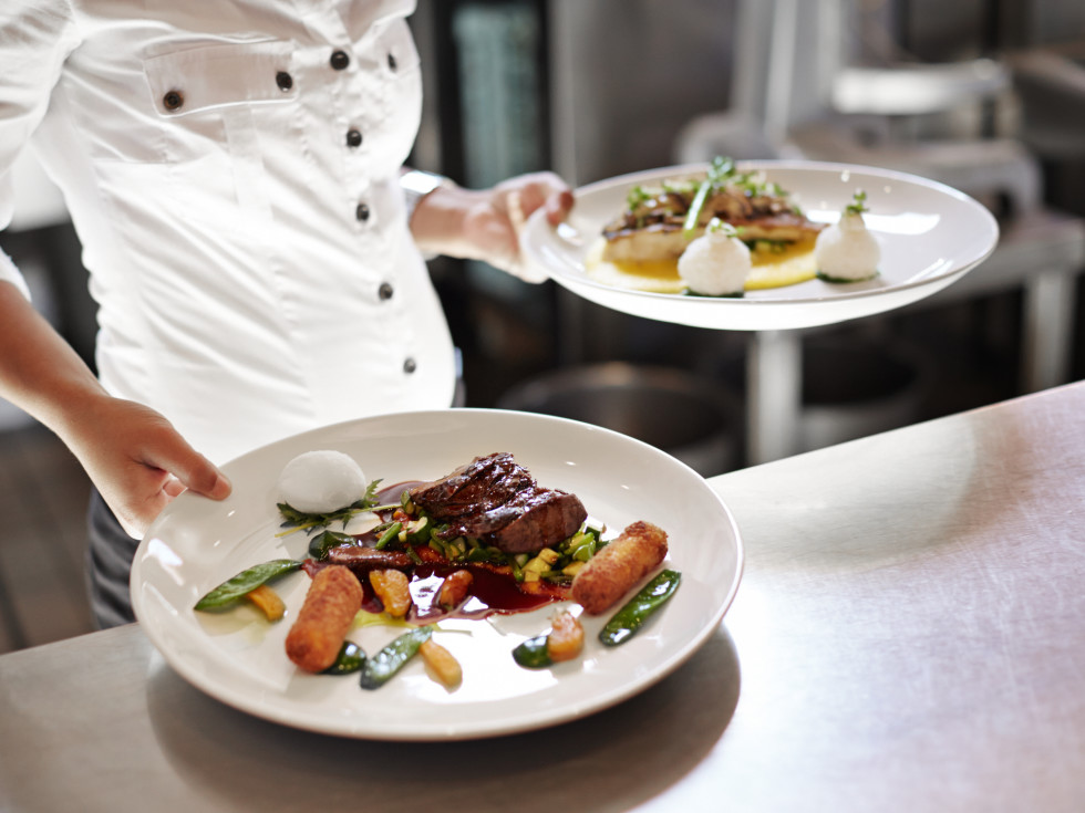 restaurant kitchen server with dishes of food