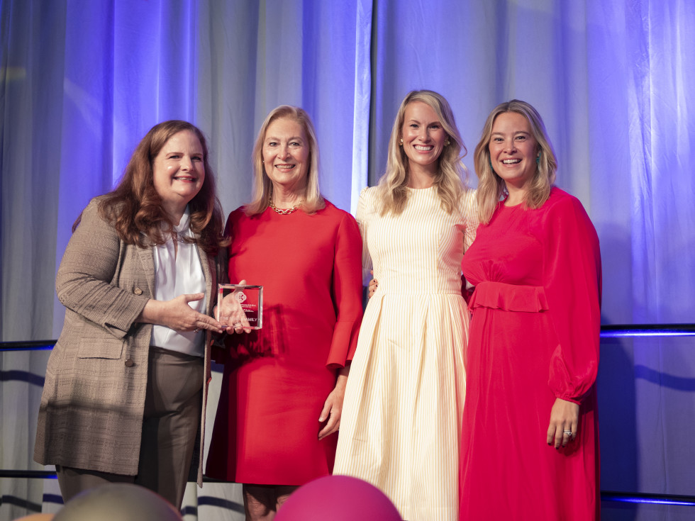 Paige McDaniel, Peggy Sewell, Josie Sewell, Jacqueline Sewell with 2021 Partners for Children Award presented to the Sewell Family