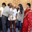 Houston Public Media Spelling Bee runnerup Raksheet Kota congratulated by his family