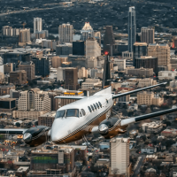 Envi Airways plane jet Austin downtown skyline