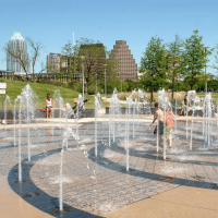 Butler Park splash pad downtown Austin skyline