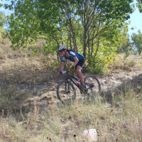 Person riding a bike through Marion Sansom Park