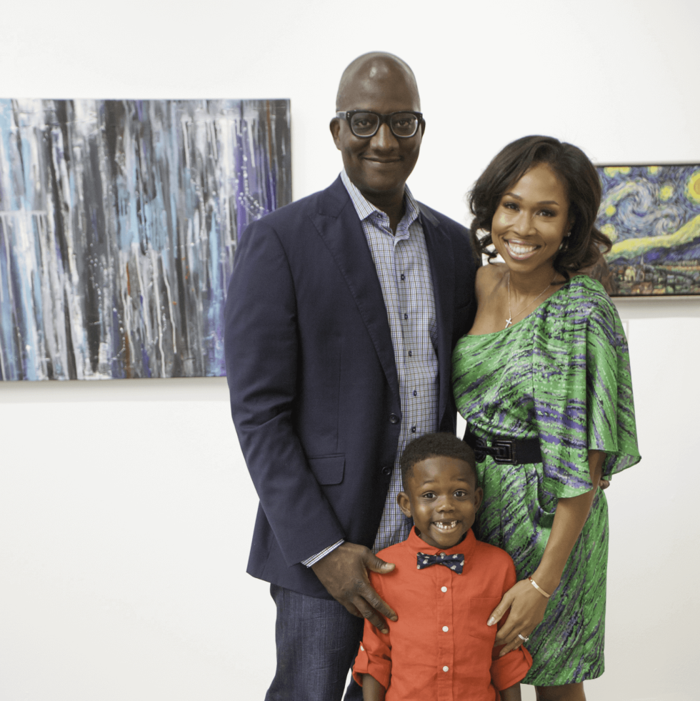 Derick Mitchell and Roslyn Bazzelle Mitchell with their son, Derick Mitchell, at the Art on the Avenue Auction Party
