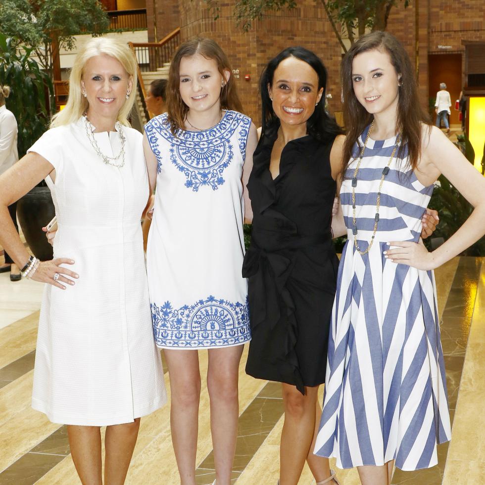 Heather Hicks, Lauren Hicks, Joanna Clarke, vice president of development, Community Partners of Dallas, and Julia Hicks