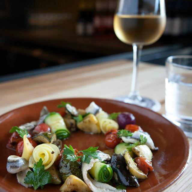 Bullfight Austin restaurant Spanish food plate dish wine glass
