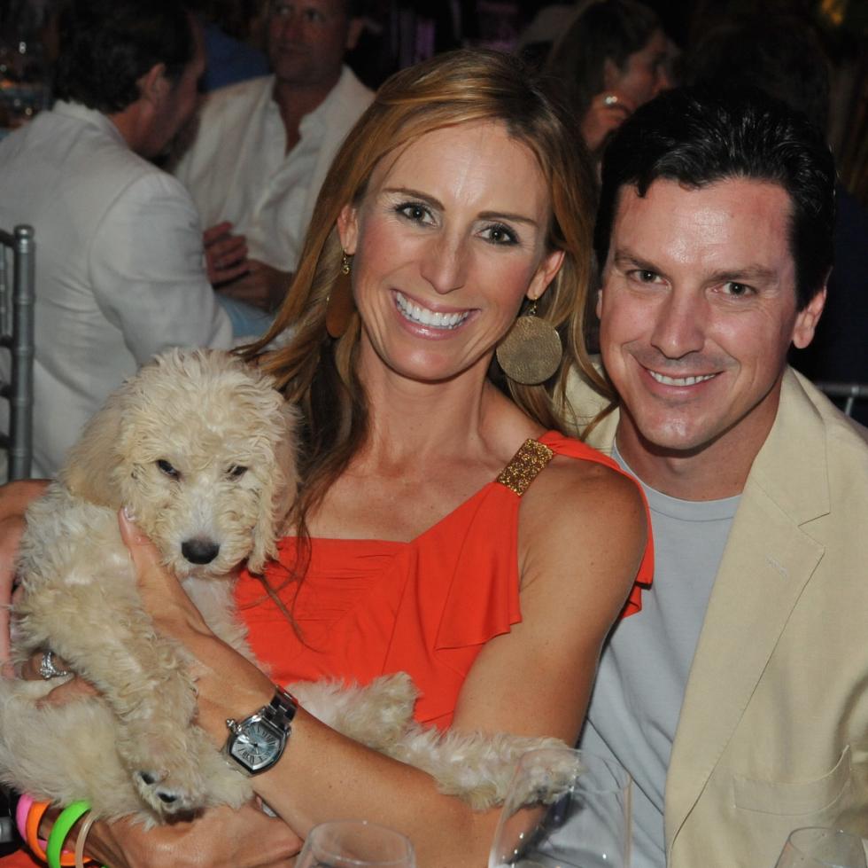Labradoodle bid winners Brooke and Jeff Gunst at Miami Vice Children's Museum Gala