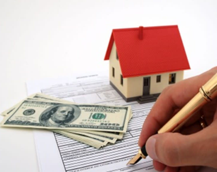 Signing deed to a house with money