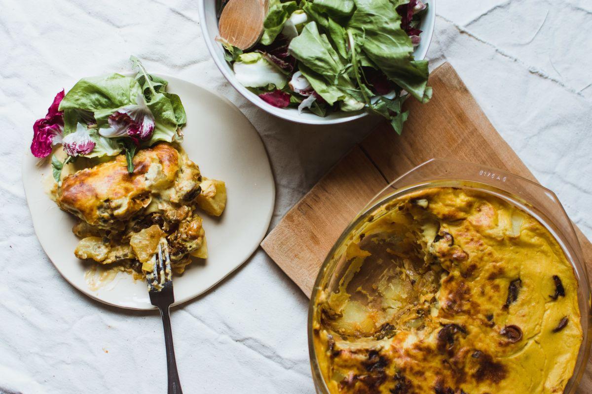 Vegan tartiflette served with some lettuce.