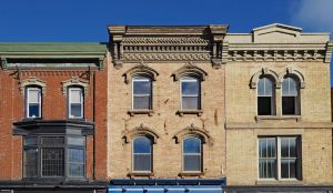 sell a house image: picture of three apartment buildings in shabby condition