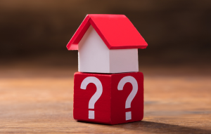 RentRedi FAQ image: picture of a toy house on a red block with white question marks on it