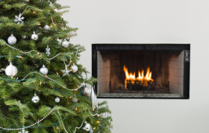 holiday fires image: christmas tree in front of a fireplace