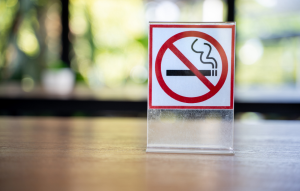 Getting rid of cigarette smoke smell image: no smoking sign sitting on a desk