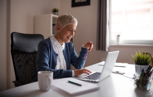 rental property investment: older woman on laptop