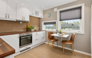 improving the appeal of your rental image: small modern kitchen with little table by window