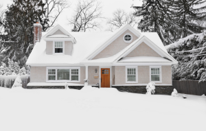 Landlord Inspection Checklist image of a snow-covered single-family house