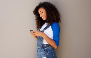 lease signing: woman smiling at phone