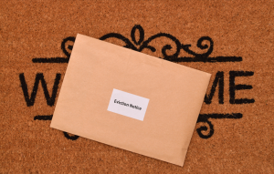 eviction letter on a welcome mat