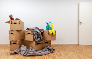 lease termination letter: picture of moving boxes and cleaning supplies