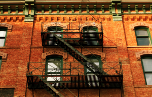 new york landlord tenant laws image of brooklyn walk up apartment and fire escape