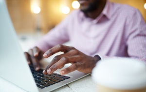 rentredi vs tenantcloud: business man's hands typing on laptop
