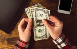 hands holding cash for pay rent with cash blog