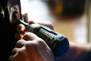 make property repairs amid covid-19 header image: two hands using a drill to make a repair