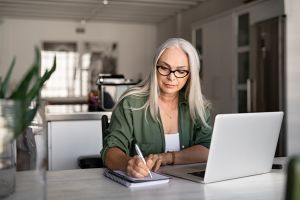 get rent ready image: Senior fashionable woman working at home