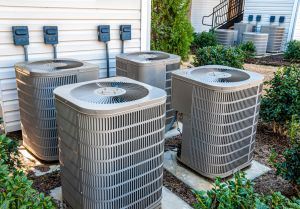 hvac mistakes hero image: picture of four havac units sitting outside a houce