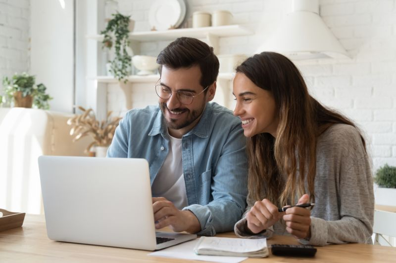 rentredi vs zillow rental manager: image of happy young couple on their laptop