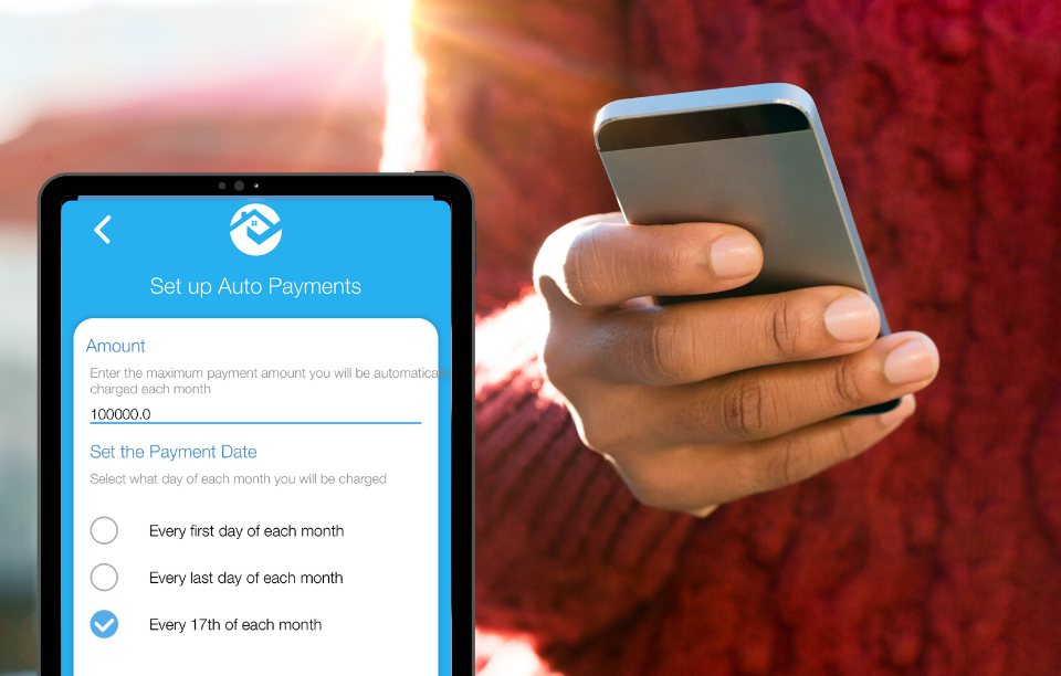 tenant auto-pay image: image of woman's hand holding a phone with a burgundy sweater on, overlayed is a screenshot of RentRedi's tenant auto-pay image in a phone frame