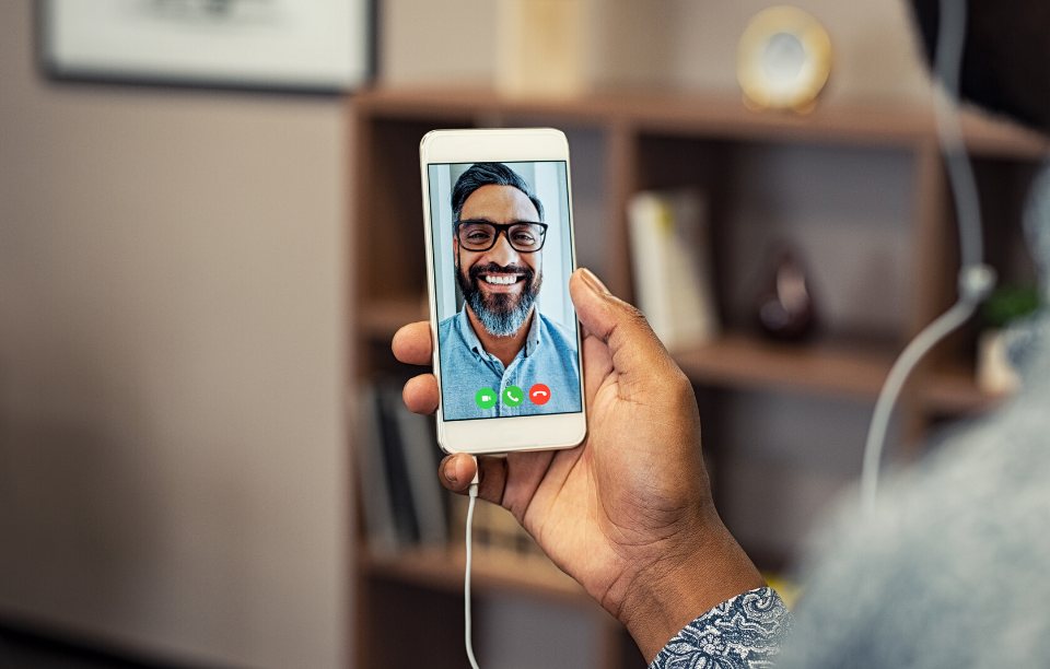 stay connected with tenants: image of a woman on a video call with a man with glasses