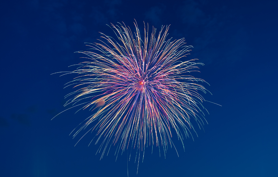 rental property damage from fireworks image: red and green circular fireworks in a night sky