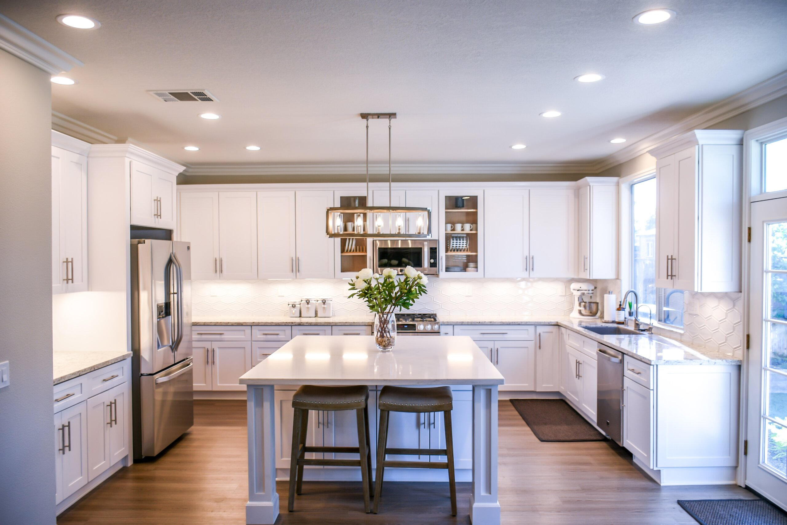 open house during covid-19 header image: pciture of a well-lit kitchen with white cupboards and hardwood floor