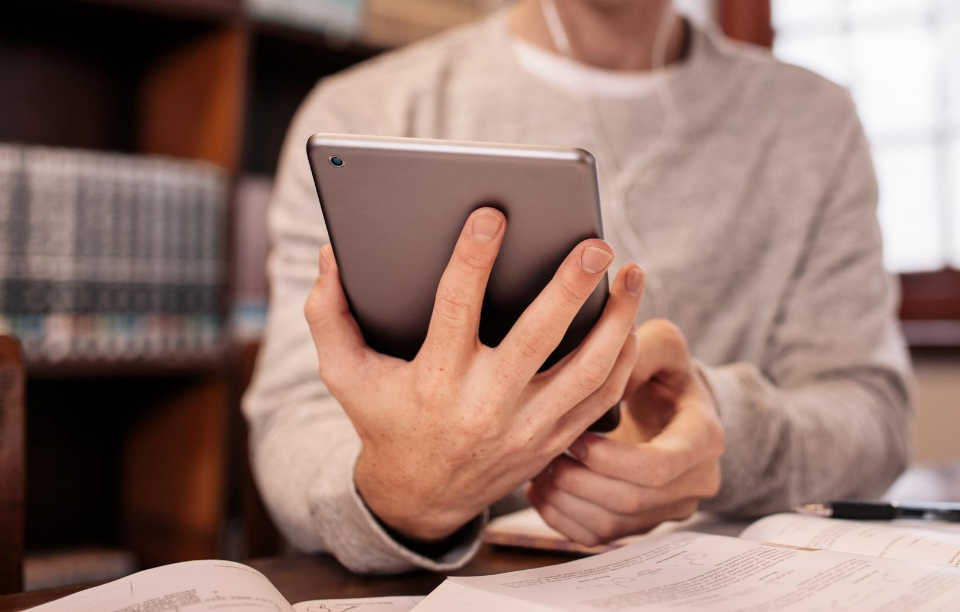 tech will change property management header image shown: person's hand holding an ipad