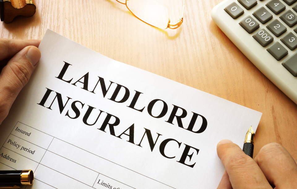 """landlord insurance header image: picture of a fingers holding a paper that says """"Landlord Insurance"""" in bold font"""